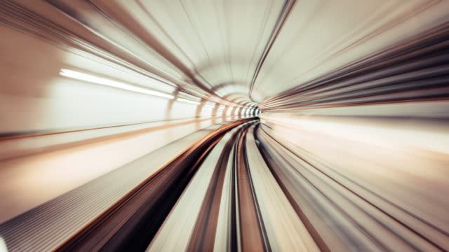 t/l motion blur of metro driving to city - vanishing point stock videos & royalty-free footage