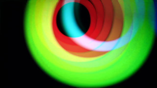 Motion colorful light rings with color surge effect.