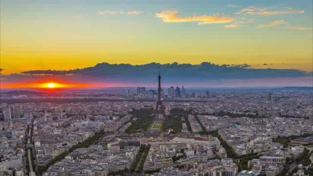 Motion control day to night time-lapse of sunset over Paris skyline and Eiffel Tower seen from Tour Montparnasse.