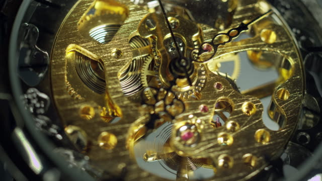 motion control macro shot of pocket watch. - 懐中時計点の映像素材/bロール