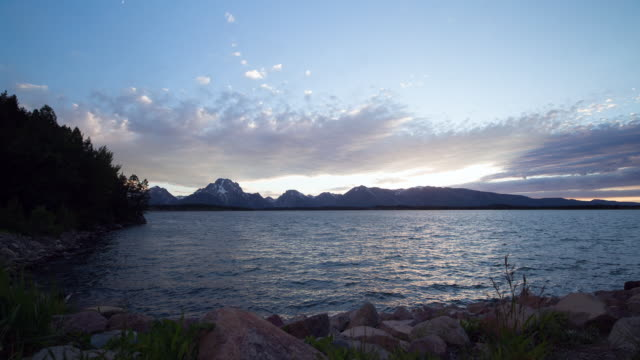 motion control time lapse of jenny lake and grand teton mountains at sunset - grand teton stock-videos und b-roll-filmmaterial