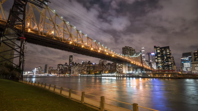 Motion controlled panning time lapse, Night. Ed Koch Queensboro 59th Street Bridge. Roosevelt Island, Nyc Manhattan.