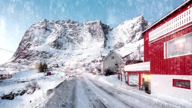 motion effect of snowing on scandinavian village in winter at lofoten islands - scandinavian culture stock videos and b-roll footage