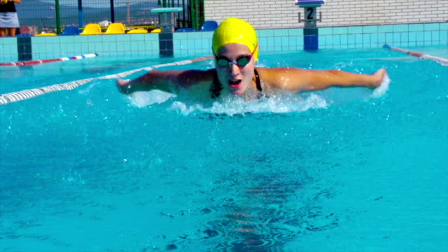 hd motion effect: young women swimming butterfly stroke outdoors - butterfly stroke stock videos and b-roll footage