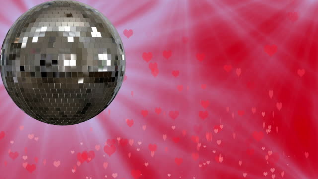 Motion graphic of revolving mirror ball with hearts background