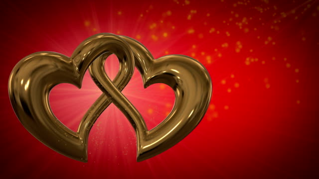 Motion graphic of two intersecting gold hearts