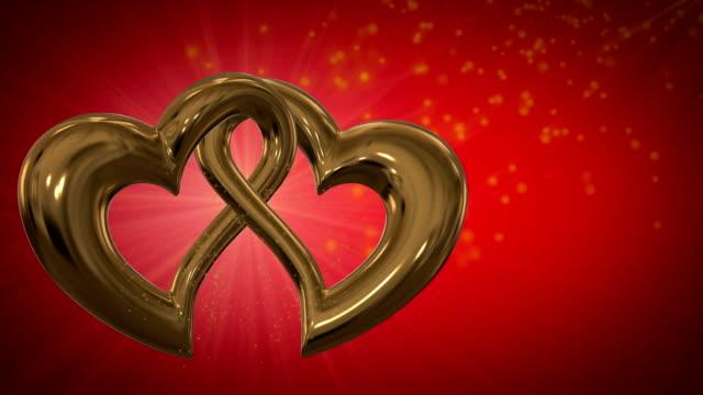 stockvideo's en b-roll-footage met motion graphic of two intersecting gold hearts - aan elkaar bevestigd