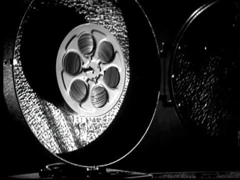 b/w cu 1936 motion picture film reel unwinding film - resting stock videos & royalty-free footage