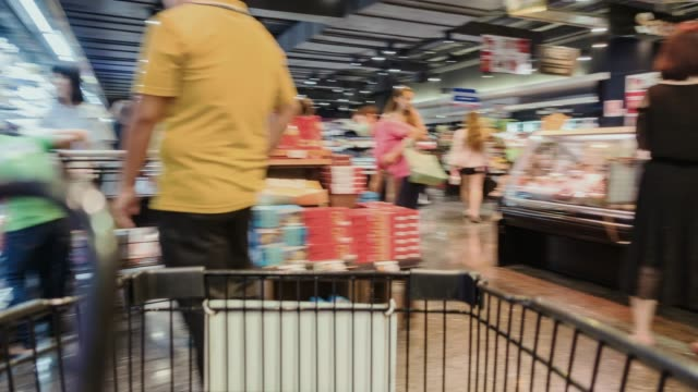 motion shopping in a supermarket. - red bell pepper stock videos & royalty-free footage