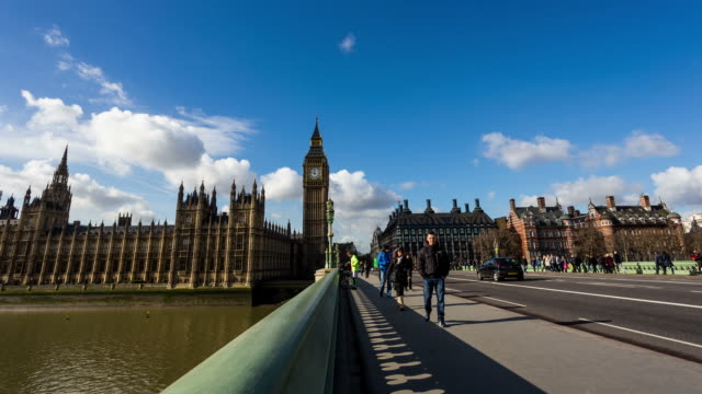LONDON - CIRCA 2013: Motion time lapse of Westminster from the bridge, with tourist, traffic in a sunny and cloudy day
