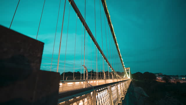motion time lapse shot on a slider of traffic light trails as cars drive across clifton suspension bridge at night on august 03 in bristol, united... - blurred motion stock videos & royalty-free footage