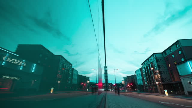 motion time lapse shot on a slider of traffic light trails on a city street at night, reflected in the windows of a glass building on august 03 in... - blurred motion stock videos & royalty-free footage