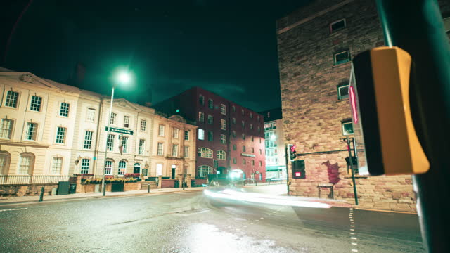motion time lapse shot on a slider of traffic light trails over a pedestrian crossing on a city street at night on august 03 in bristol, united... - blurred motion stock videos & royalty-free footage