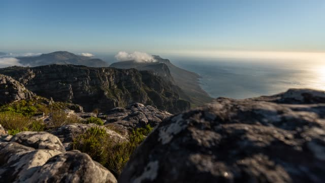 Motion timelapse at golden hour of Cape Town coastline