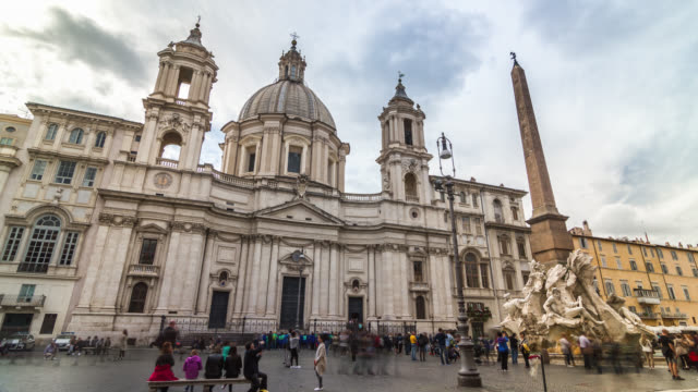 motion timelapse of people crowd at the navona square (piazza navona) near sant'agnese in agone church and fountain of the four rivers. rome, italy. april, 2016. - obelisk stock videos & royalty-free footage