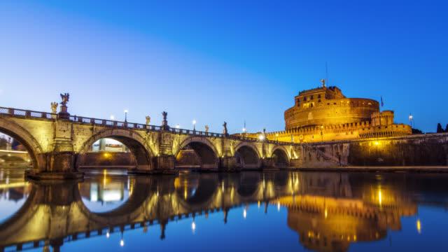 motion timelapse (hyperlapse) of saint angel's (castel sant'angelo) castle and bridge at sunset. rome, italy. april, 2016. - サンタンジェロ橋点の映像素材/bロール