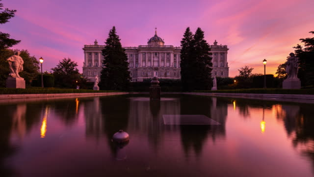 motion timelapse of the royal palace of madrid at sunset - palace video stock e b–roll