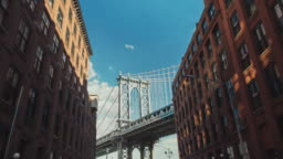 Motion timelapse: The famous Brooklyn Bridge, a popular tourist attraction in New York