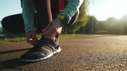 Motivated female runner doing her daily training.
