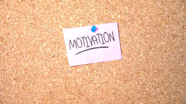 motivation word on paper pinning up on corkboard by a man - plank stock videos & royalty-free footage