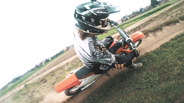 POV Motocross biker riding on a dirt track