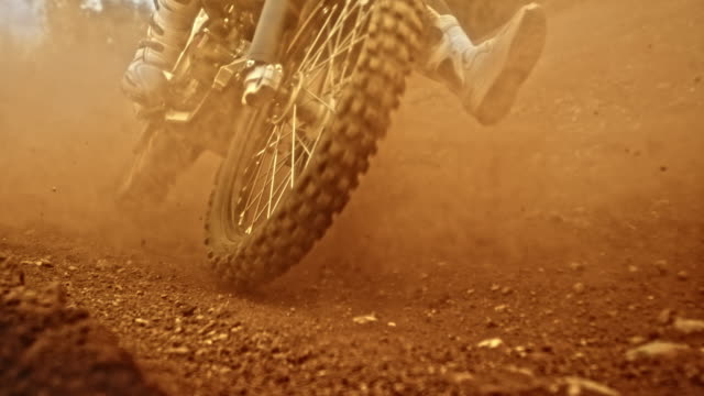 slo mo motocross bikes being ridden through a turn - 30 39 years stock videos & royalty-free footage