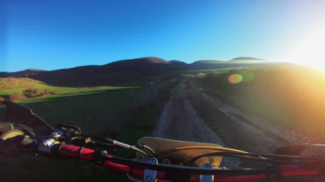 motocross enduro motorbike riding point of view pov - gara off road video stock e b–roll