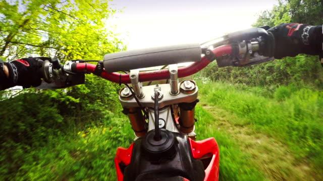 motocross enduro motorbike riding pov - throttle stock videos & royalty-free footage