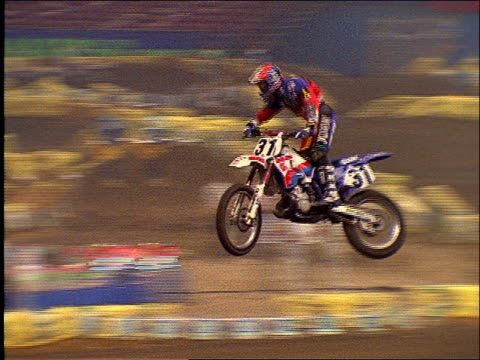 motocross motorcycle jumping over hill in race / king dome, seattle - lachaos stock videos & royalty-free footage