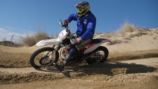 motocross motorcycles riding on a beach by men. - slow motion - crash helmet stock videos & royalty-free footage