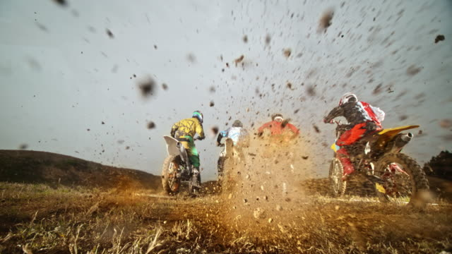 slo mo motocross racers taking off and bursting gravel - quartet stock videos & royalty-free footage