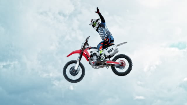 speed ramp motocross rider doing a no hand trick - motorbike stock videos & royalty-free footage