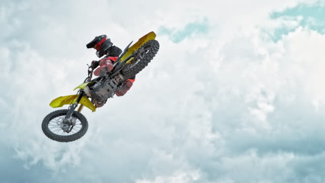 speed ramp motocross rider jumping into air - professional sportsperson stock videos & royalty-free footage