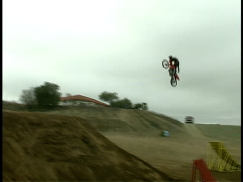 ms, ts, composite, motocross rider jumping mid air off ramp, usa - film composite stock videos & royalty-free footage