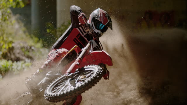 ms motocross rider speeding, sliding on dirt course - cycling stock videos & royalty-free footage