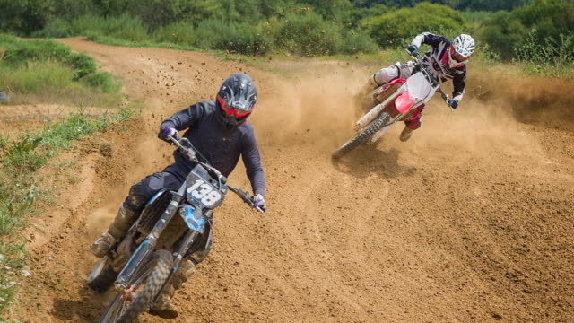 motocross riders competing on dirt track - skill stock videos & royalty-free footage