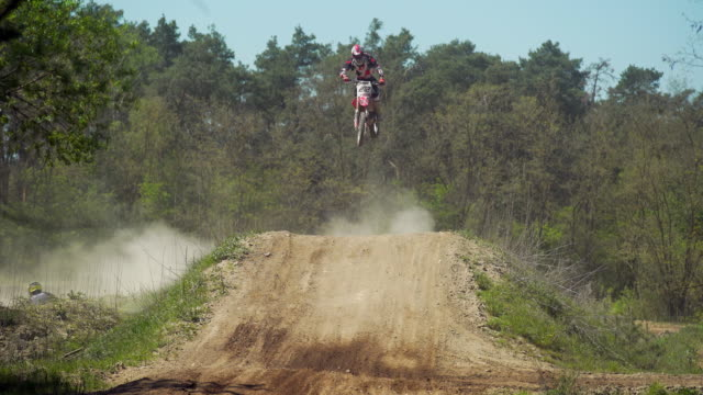 Motocross Riders Jumping On Track