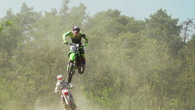 SLO MO Motocross Riders Making High Jumps