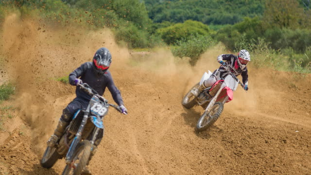 motocross riders racing through a turn - 4x4 stock videos and b-roll footage