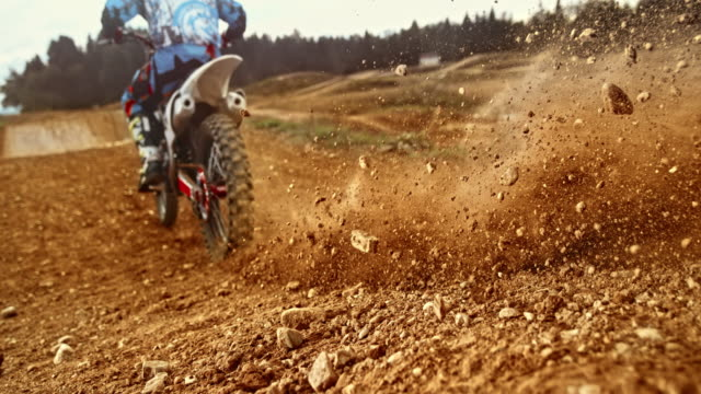 stockvideo's en b-roll-footage met slo mo motocross band graven in grind - competition