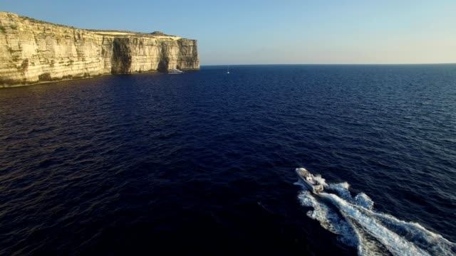 motor boat and yacht in azure window of malta - malta stock videos & royalty-free footage