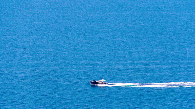 ls motor boat cruising the sea - motorboat stock videos and b-roll footage