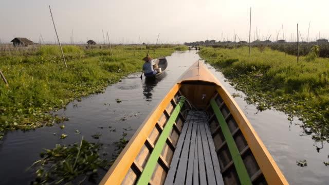 motor boat exploring inle lake, myanmar - standing water stock videos & royalty-free footage