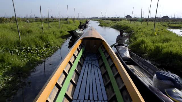 motor boat exploring inle lake, myanmar - longtail boat stock videos & royalty-free footage