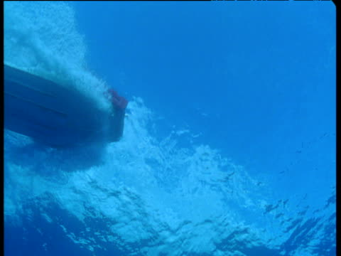 Motor boat passes overhead on ocean surface, Hawaii