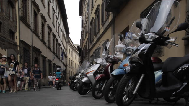 motor cycles on via di neri, florence, tuscany, italy, europe - scooter stock videos & royalty-free footage