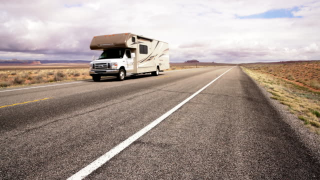 ds motor home driving through a desert - camper van stock videos and b-roll footage