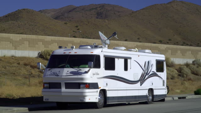 ms motor home parked in desert landscape, palmdale, california, usa - camper van stock videos and b-roll footage