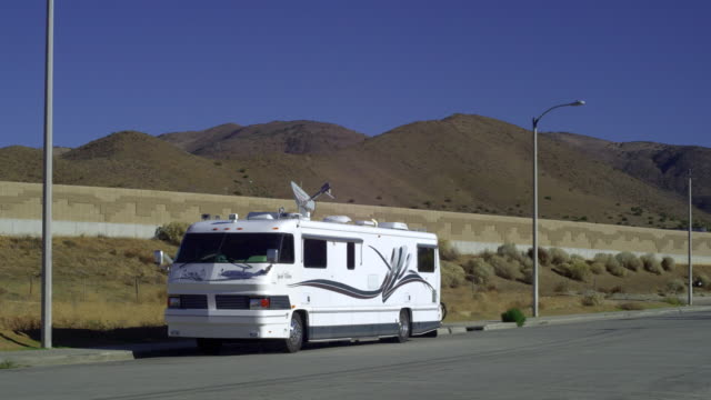 ws motor home parked in desert landscape, palmdale, california, usa - palmdale stock videos and b-roll footage