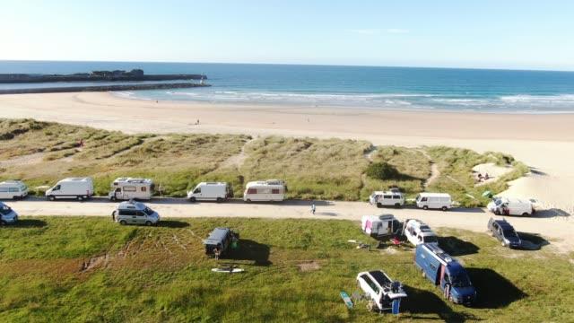 motor homes and camper vans parked by a beach - camper van stock videos & royalty-free footage